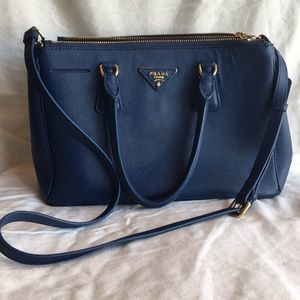 Blue Prada handbag.